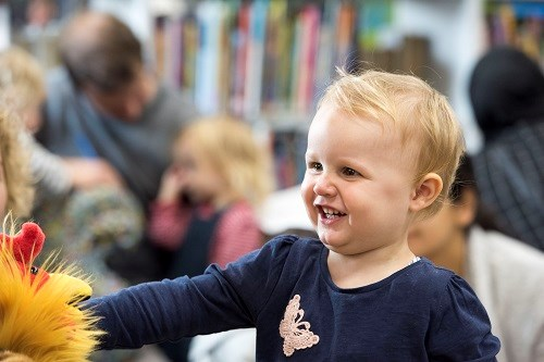 laughing toddler at library event